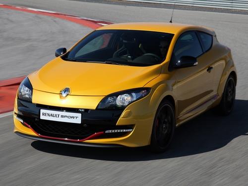 Фото автомобиля Renault Megane 3 поколение [рестайлинг], ракурс: 45 цвет: желтый
