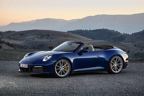 Фото автомобиля Porsche 911 992, ракурс: 45 цвет: синий