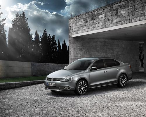 Фото автомобиля Volkswagen Jetta 6 поколение, ракурс: 45 цвет: серый