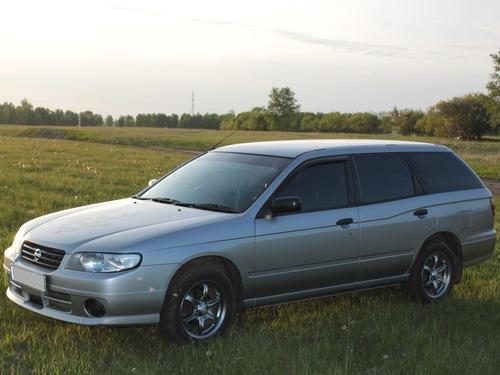 Фото автомобиля Nissan Expert W11, ракурс: 45 цвет: серебряный