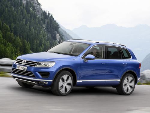 Фото автомобиля Volkswagen Touareg 2 поколение [рестайлинг], ракурс: 45 цвет: синий