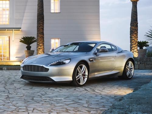 Фото автомобиля Aston Martin DB9 1 поколение [2-й рестайлинг], ракурс: 45 цвет: серый