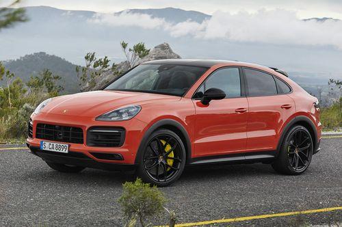 Фото автомобиля Porsche Cayenne PO536, ракурс: 45 цвет: оранжевый