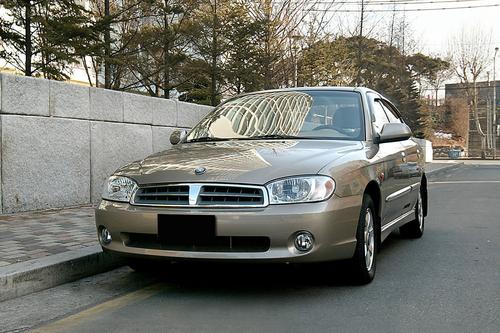 Фото автомобиля Kia Spectra 1 поколение [рестайлинг], ракурс: 45