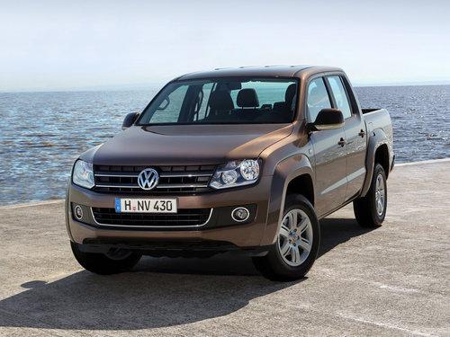 Фото автомобиля Volkswagen Amarok 1 поколение, ракурс: 45 цвет: коричневый