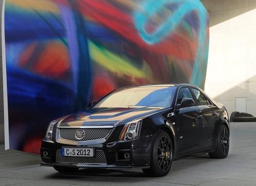 Фото автомобиля Cadillac CTS 2 поколение, ракурс: 45 цвет: черный