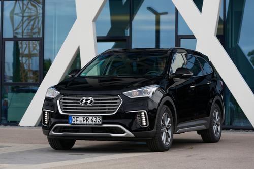 Фото автомобиля Hyundai Santa Fe DM [рестайлинг], ракурс: 45 цвет: черный