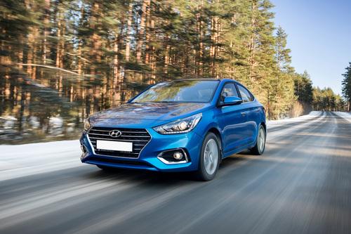 Фото автомобиля Hyundai Solaris 2 поколение, ракурс: 45 цвет: синий
