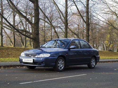 Фото автомобиля Kia Spectra 1 поколение [рестайлинг], ракурс: 45 цвет: синий