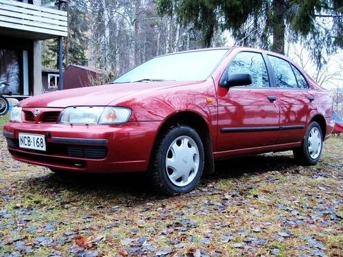 Фото автомобиля Nissan Almera N15, ракурс: 45 цвет: красный
