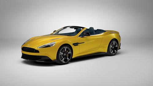 Фото автомобиля Aston Martin Vanquish 2 поколение, ракурс: 45 цвет: желтый