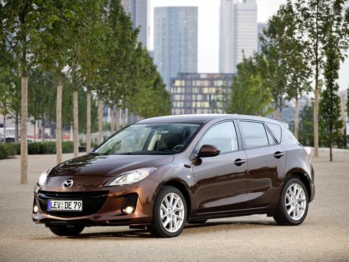 Фото автомобиля Mazda 3 BL [рестайлинг], ракурс: 45 цвет: коричневый