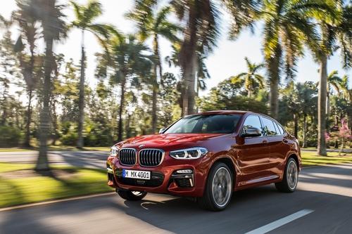 Фото автомобиля BMW X4 G02, ракурс: 45 цвет: красный