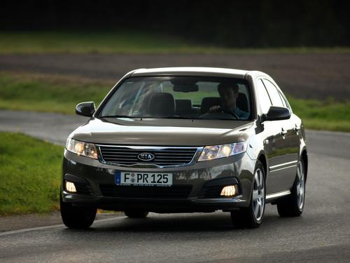 Фото автомобиля Kia Magentis 2 поколение [рестайлинг], ракурс: 45 цвет: коричневый