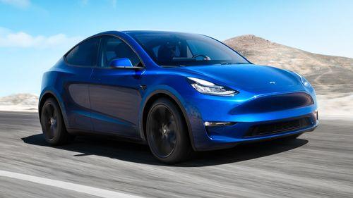 Фото автомобиля Tesla Model Y 1 поколение, ракурс: 315 цвет: синий