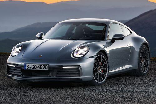 Фото автомобиля Porsche 911 992, ракурс: 45 цвет: серый