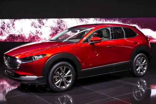 Фото автомобиля Mazda CX-30 1 поколение, ракурс: 45 цвет: красный