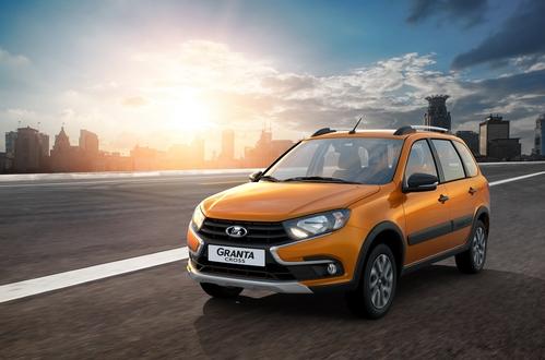 Фото автомобиля ВАЗ (Lada) Granta 1 поколение [рестайлинг], ракурс: 45 цвет: оранжевый