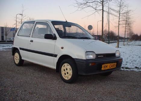 Фото автомобиля Daihatsu Cuore L200, ракурс: 45