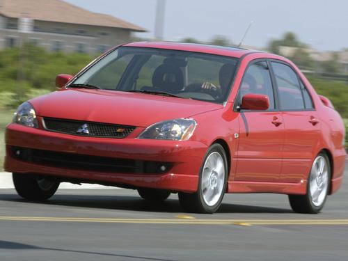 Фото автомобиля Mitsubishi Lancer IX [рестайлинг], ракурс: 45