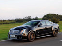 Фото авто Cadillac CTS 2 поколение, ракурс: 45 цвет: черный