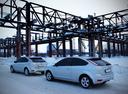 Фото авто Ford Focus 2 поколение [рестайлинг], ракурс: 135 цвет: белый