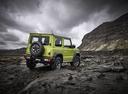 Фото авто Suzuki Jimny 4 поколение, ракурс: 225 цвет: зеленый