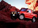 Фото авто Mitsubishi Pajero 2 поколение, ракурс: 45 цвет: красный