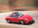 Фото авто Porsche 911 997, ракурс: 45 цвет: красный