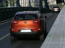 Фото авто Kia Sportage 3 поколение, ракурс: 180 цвет: оранжевый