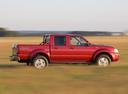 Фото авто Nissan NP300 1 поколение, ракурс: 270 цвет: красный