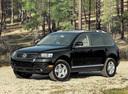 Фото авто Volkswagen Touareg 1 поколение, ракурс: 45 цвет: черный