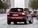Фото авто Mazda CX-7 1 поколение, ракурс: 225 цвет: красный