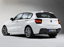Фото авто BMW 1 серия F20/F21, ракурс: 135 цвет: белый
