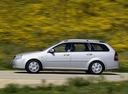 Фото авто Chevrolet Lacetti 1 поколение, ракурс: 90 цвет: серебряный