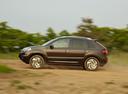 Фото авто Renault Koleos 1 поколение [2-й рестайлинг], ракурс: 90 цвет: коричневый