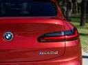Фото авто BMW X4 G02, ракурс: задние фонари цвет: красный