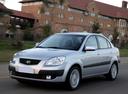 Фото авто Kia Rio 2 поколение, ракурс: 45 цвет: серебряный