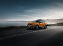 Фото авто Renault Kaptur 1 поколение, ракурс: 45 цвет: оранжевый