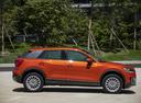 Фото авто Audi Q2 1 поколение, ракурс: 270 цвет: оранжевый
