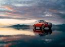 Фото авто Rolls-Royce Cullinan 1 поколение, ракурс: 315 цвет: красный