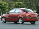 Фото авто Kia Rio 2 поколение, ракурс: 135 цвет: красный