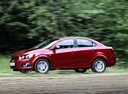 Фото авто Chevrolet Aveo T300, ракурс: 90 цвет: красный