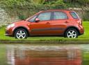 Фото авто Suzuki SX4 1 поколение [рестайлинг], ракурс: 90 цвет: оранжевый