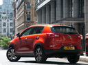 Фото авто Kia Sportage 3 поколение, ракурс: 135 цвет: оранжевый