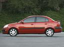Фото авто Kia Rio 2 поколение, ракурс: 90 цвет: красный