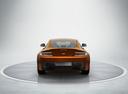 Фото авто Aston Martin Vantage 3 поколение [2-й рестайлинг], ракурс: 180 цвет: оранжевый