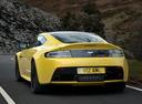 Фото авто Aston Martin Vantage 3 поколение [2-й рестайлинг], ракурс: 135 цвет: желтый