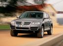 Фото авто Volkswagen Touareg 1 поколение, ракурс: 45 цвет: серый