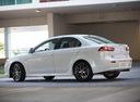 Фото авто Mitsubishi Lancer X [2-й рестайлинг], ракурс: 135 цвет: белый